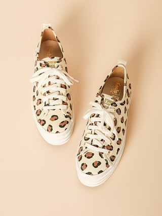 Model in cream leopard Keds Triple Up  Sneakers