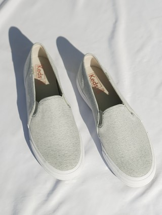 Model in light grey Keds Double Decker Heathered Woven Slip On Sneaker
