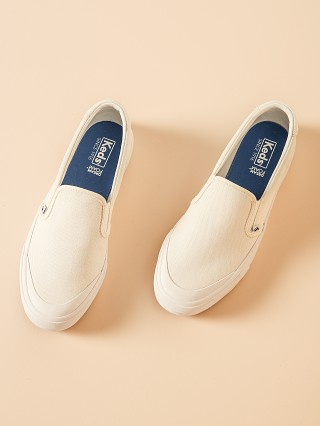 Model in white Keds Crew Kick 75 Slip On Canvas Sneaker