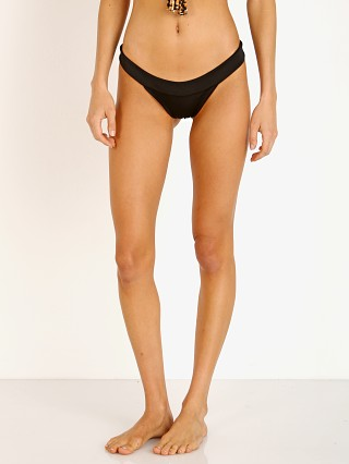 Model in black with cheetah lining Indah Rama Seamless Band Bikini Bottom