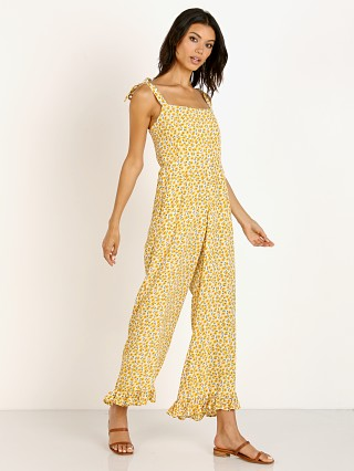 Model in marguerite yellow floral Faithfull the Brand Frankie Jumpsuit