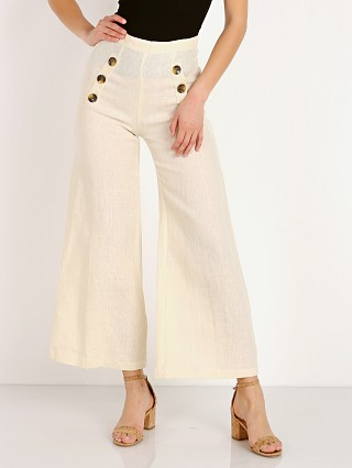 Model in plain cream Faithfull the Brand Adita Pants