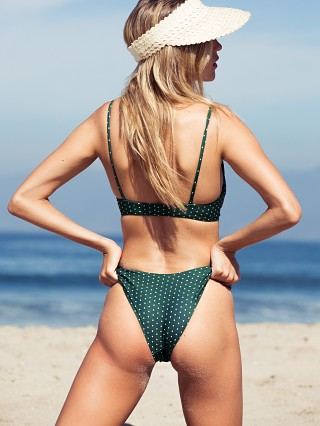 Model in herbal daisy dot Stone Fox Swim Bowie Bottom