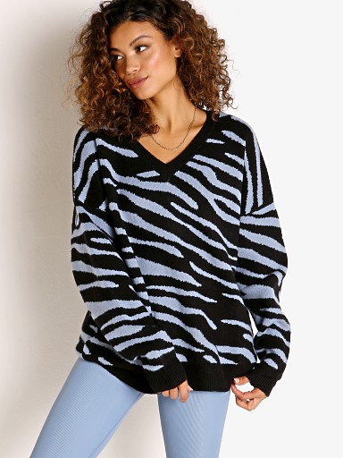 Model in pewter zebra Beach Riot V-Neck Oversized Sweater