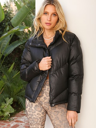 Model in black BB Dakota Answer My Layer Puffer Jacket