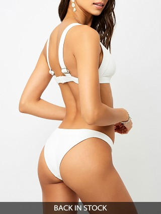 Model in white Frankie's Bikinis Grace Bikini Bottom