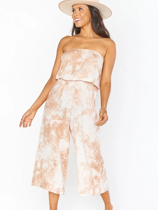 Model in tan Show Me Your Mumu Estelle Jumpsuit Twisted