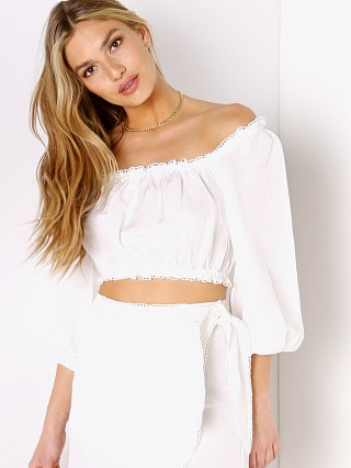 Model in white linen Show Me Your Mumu Claudia Crop Top