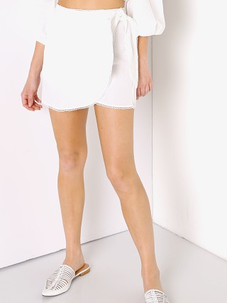 Model in white linen Show Me Your Mumu Iva Wrap Skirt
