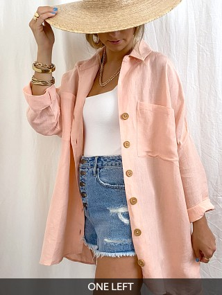 Model in pink linen Show Me Your Mumu John Button Down Shirt