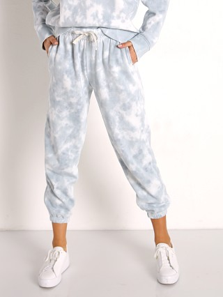 Model in blue mirage tie dye Richer Poorer Recycled Fleece Sweatpant