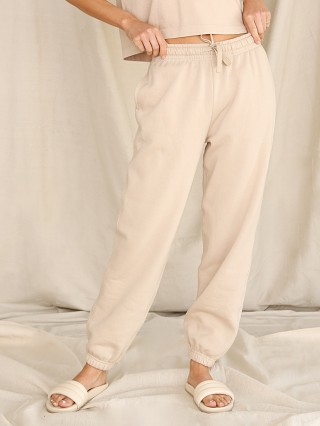 Model in sandstorm Richer Poorer Recycled Fleece Sweatpant