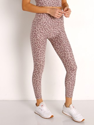 Model in chai cocoa leopard Beyond Yoga Spacedye Caught In The Midi High Waisted Legging Cha