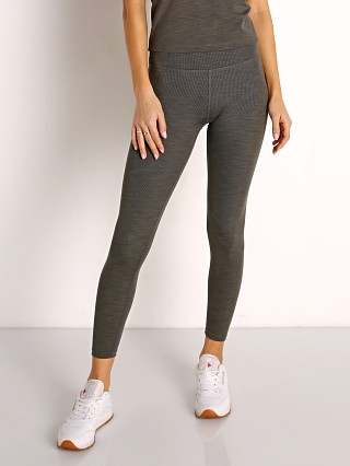 Model in smoke grey Beyond Yoga Heather Rib High Waisted Midi Legging