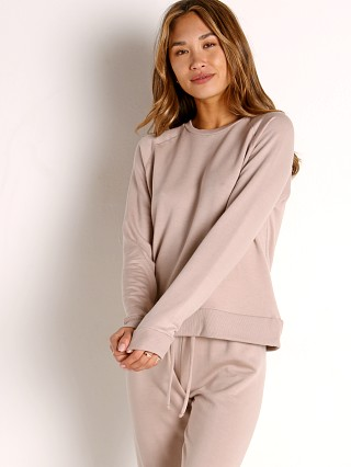 Model in chai Beyond Yoga Cozy Fleece Favorite Raglan Crew Pullover