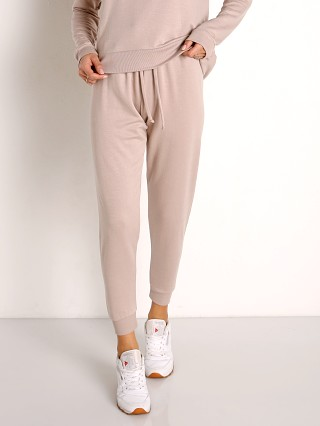Model in chai Beyond Yoga Cozy Fleece Lounge Around Midi Jogger