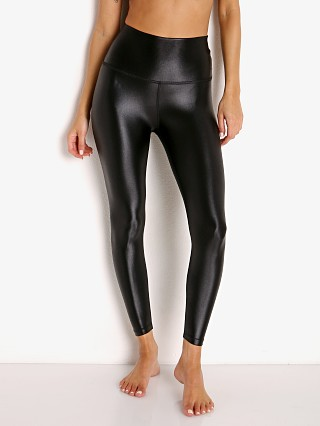 Model in black Beyond Yoga Sportgloss High Waisted Midi Legging