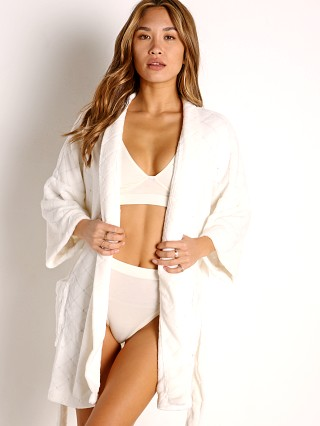Model in vanilla Z Supply Luxe Quilt Kimono