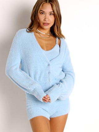 Model in sky blue L Space Daydreaming Cardigan