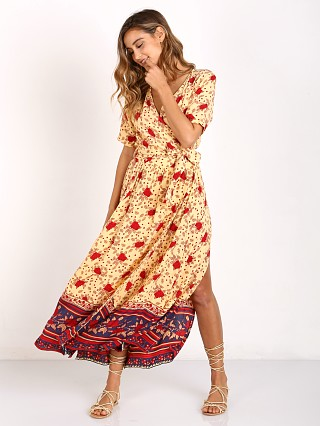 Model in rose garden print yellow Faithfull the Brand Adela Maxi