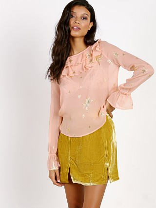 Model in rose gold For Love & Lemons Gilded Star Blouse