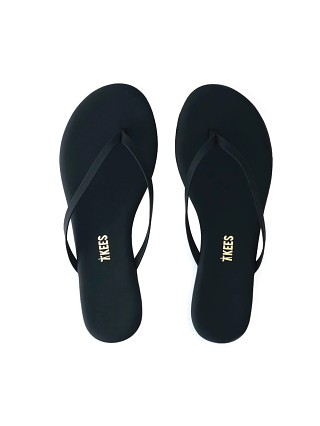 Model in matte black Tkees Lily Vegan Flip Flop Sandal