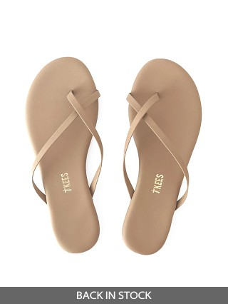 Model in matte nude Tkees Riley Vegan Leather Sandals
