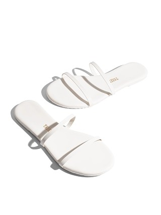 Model in cream Tkees Gemma Flip Flop Sandal