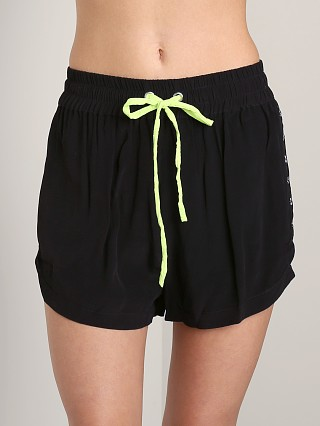 Model in black This is a Love Song Serendipity Shorts