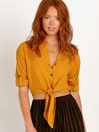 Model in plain butterscotch Faithfull the Brand Beau Rivage Top