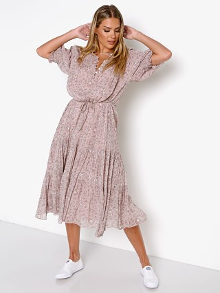 Model in meadows block Cleobella Piper Midi Dress