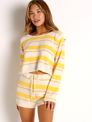 Model in sunshine stripe L Space Sun Seeker Sweater