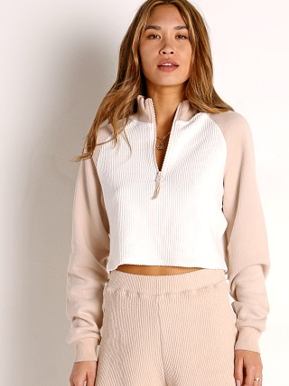 Model in cream w/ sandstone L Space Staycation Pullover