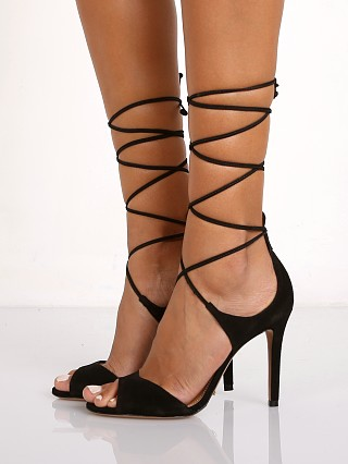 Model in black Schutz Moony Heel
