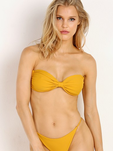 Model in mustard Storm Swim Amalfi Top