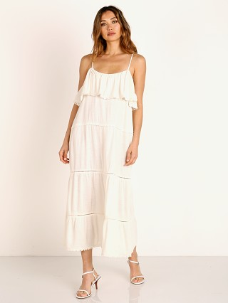 Model in white Show Me Your Mumu Ambrose Midi