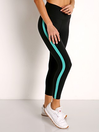 Model in black and menthol SPLITS59 Dora High Waist Airweight 7/8 Legging