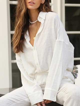 Model in ivory Indah Body Como Oversized Button Up