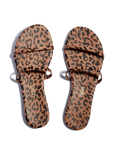 Model in cheetah Tkees Gemma Exotics Sandal