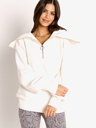 Model in ivory Varley Vine Half Zip Sweater