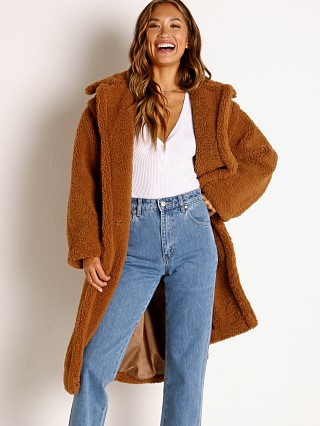 Model in camel APPARIS Daryna Faux Shearling Double Breasted Coat