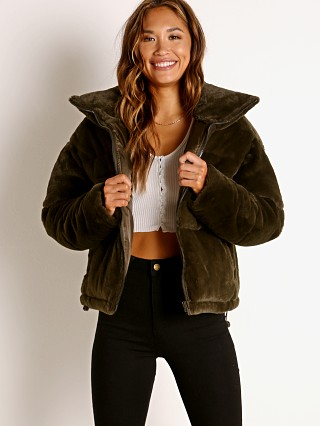 Model in army green APPARIS Billie Faux Fur Jacket
