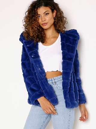 Model in true blue APPARIS Goldie Faux Fur Jacket