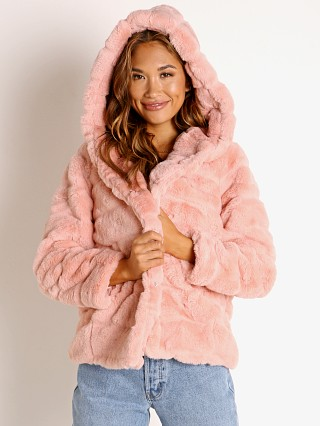 Model in peach APPARIS Goldie Faux Fur Jacket