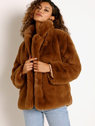 Model in camel APPARIS Manon Faux Fur Jacket