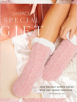 Model in pink L Space Fluffy Slipper Socks