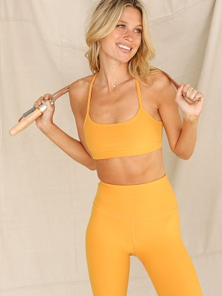 Model in sunny citrine Beyond Yoga Spacedye Slim Racerback Sports Bra