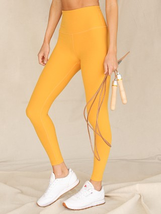 Model in sunny citrine Beyond Yoga Spacedye Midi High Waisted Legging