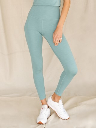 Model in mermaid green Beyond Yoga Heather Rib High Waisted Midi Legging
