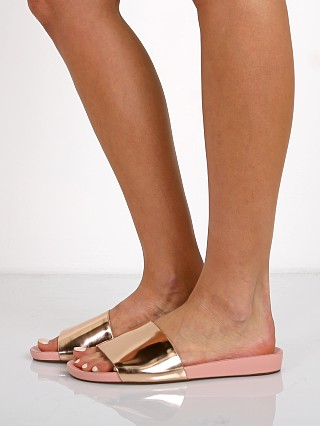 Model in rose tan Schutz Camilis Sandals